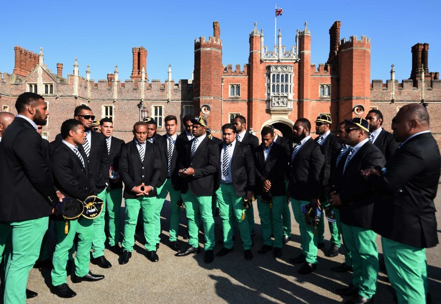 Members of the the Fiji 2015 World Cup Rugby Union squad sing outside Hampton Court Palace. (Photo by Stuart C. Wilson/Getty Images for ER2015)