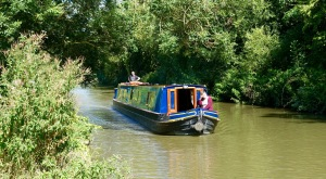 Narrow boats ply the Oxford Canal.