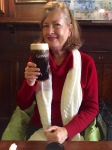 Kathy lifts a pint at the White Horse pub.