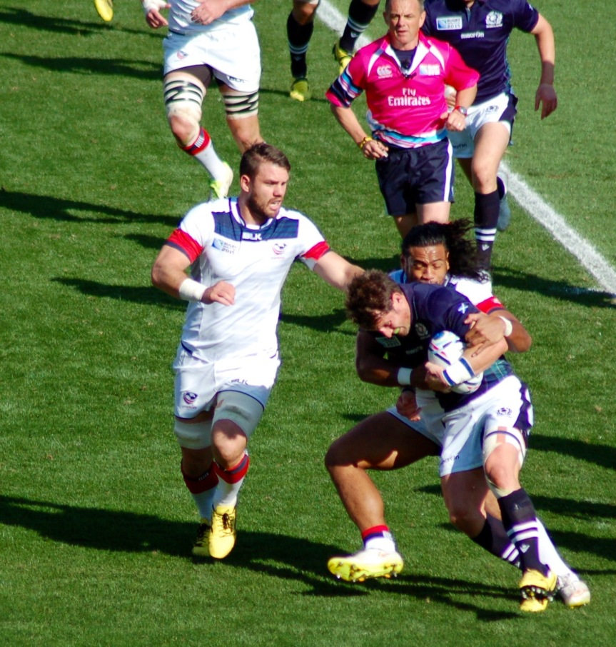 Hard tackles like this one by Thretton Palamo led to mishandling by Scotland in the first half.