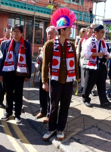 A Japan rugby fan on a Brighton street.