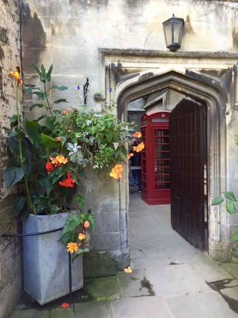 What could be more English: flowers, a red phone box, ancient walls inside Magdalen College at Oxford.