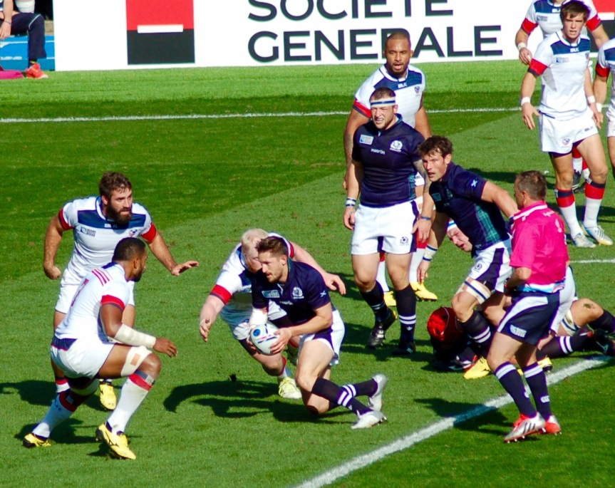 In the first half, aggressive tackling by the U.S. caused several mishandles by the Scotland team.