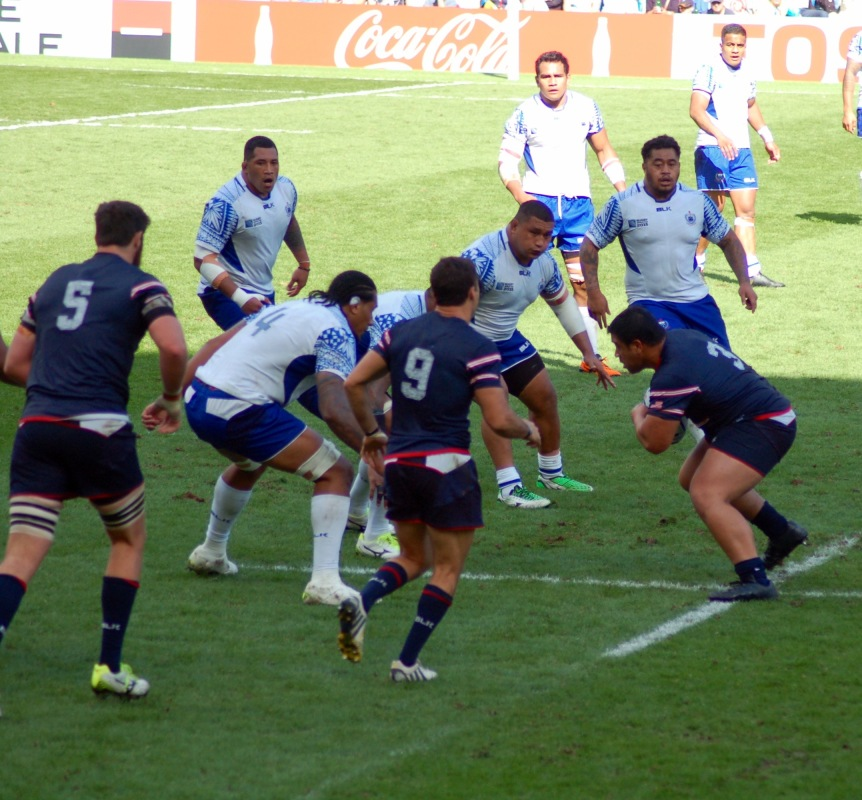 Titi Lamositele (No. 3) of Bellingham, WA, squares off against Samoan defenders.