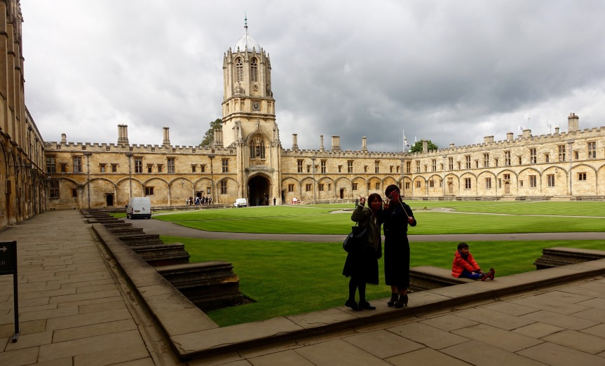 Tom Quad at Christ Church College. Selfie sticks are everywhere, and two tourists are using one here.