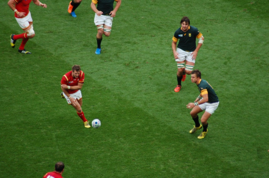 Dan Biggar has the ball out against South Africa.