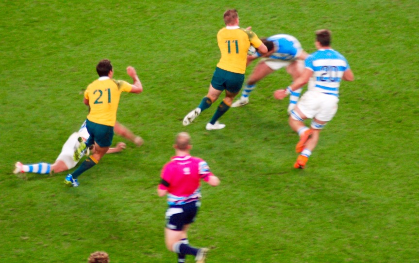Drew Mitchell wound his way through the Argentina defense, breaking tackles and sending a pass out to Adam Ashley-Cooper for his third try of the game.