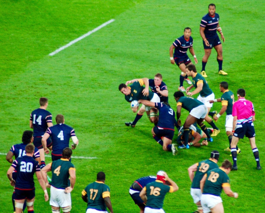 A Springbok forward pushes U.S. defenders back.