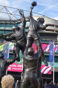 Statue of a lineout at the entrance to Twickenham Stadium.